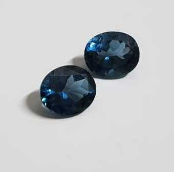London Blue Topaz Oval faceted 12x10 mm