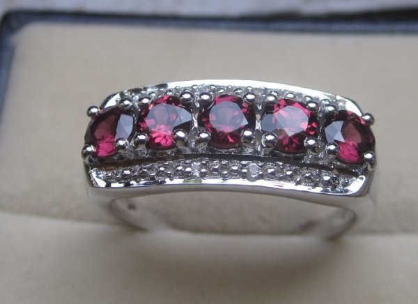 Garnet topaz channel ring