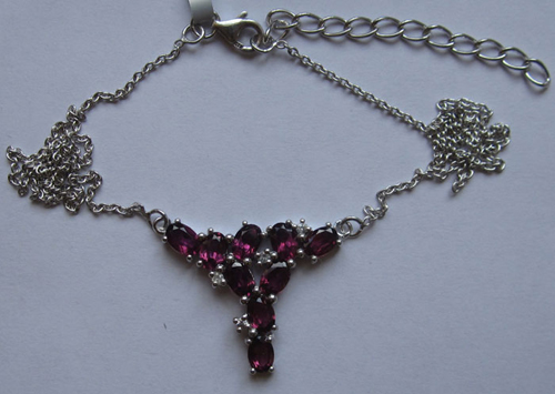 Gold Necklace With rhodolite and w. topaz