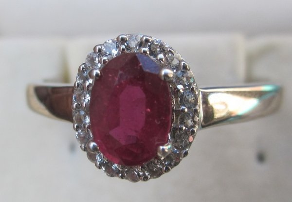 Gold Ring With ruby and topaz