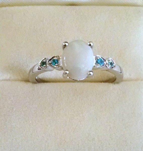 Opal and blue topaz hearts ring