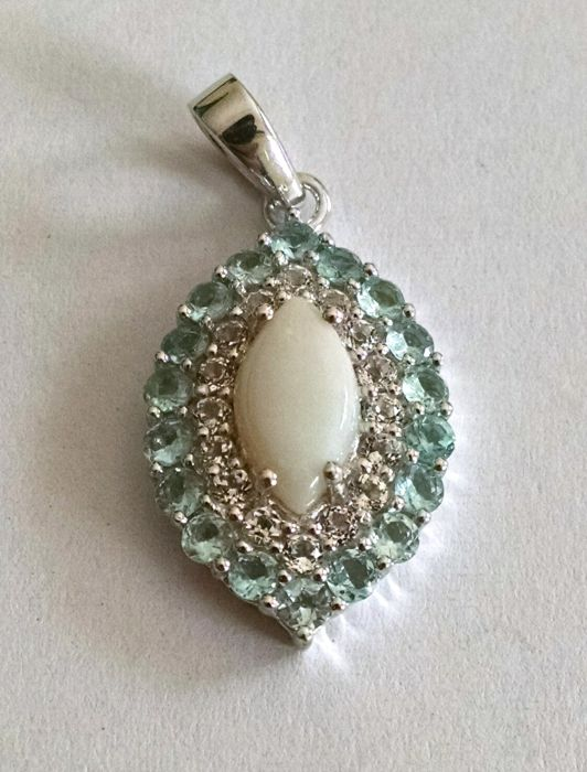 Opal cabochon pendant and sky blue and white topaz
