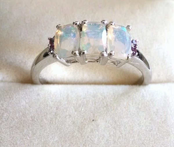 Opal cushion trilogy ring