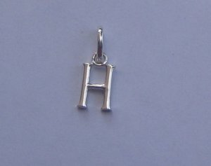 "Plaint gold charms "" H """