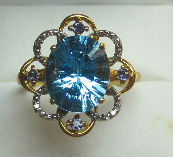Ring With Diamonds,iolite, and swiss blue topaz