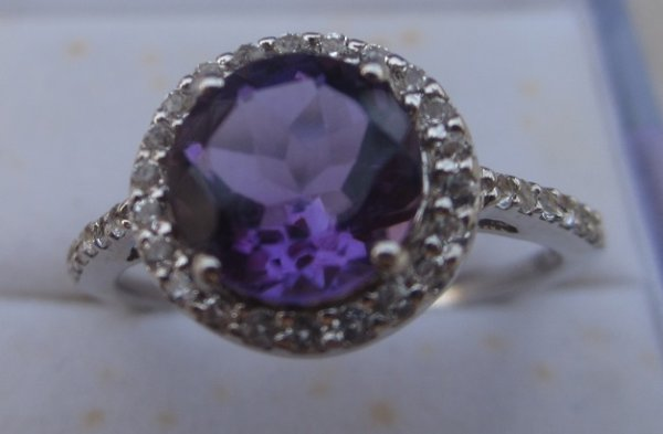 Ring with rd amethyst and topaz