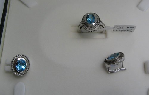Set With Diamonds & blue topaz.